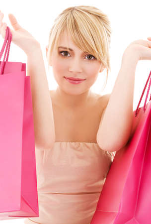 happy teenage girl with pink shopping bags Stock Photo - 4900549