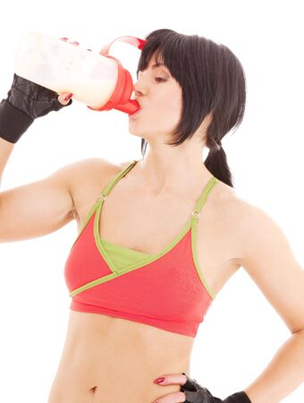 lovely fitness instructor with protein shake bottle Stock Photo - 4900547