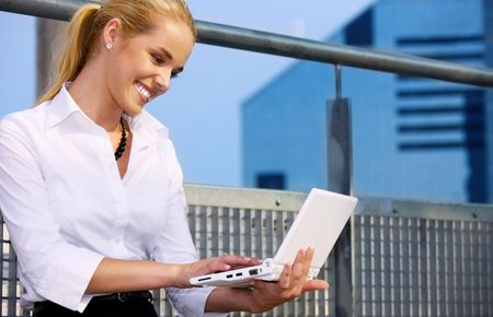 picture of happy businesswoman with laptop computer Stock Photo - 4900530