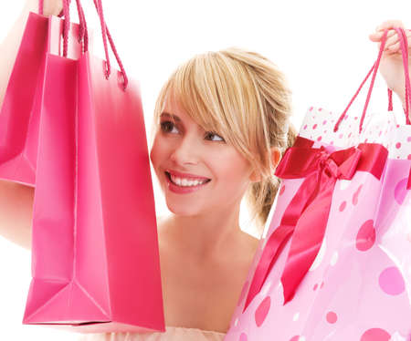 happy teenage girl with pink shopping bags Stock Photo - 4918256