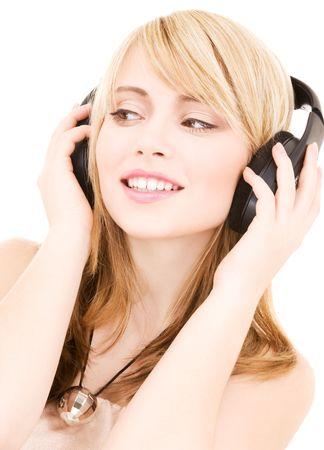 happy teenage girl in headphones over white