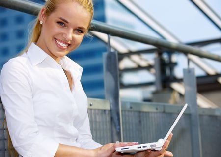picture of happy businesswoman with laptop computer Stock Photo - 4918239
