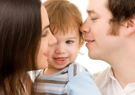 bright picture of happy family over white (focus on baby)