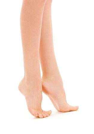 long feet: picture of slim female legs over white