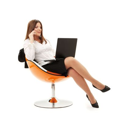 businesswoman in chair with laptop and phone over white photo
