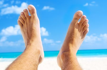 hairy legs: picture of male legs over tropical beach background