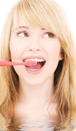 picture of happy girl with toothbrush over white Stock Photo - 4946552