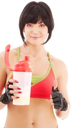 lovely fitness instructor with protein shake bottle Stock Photo - 4946548