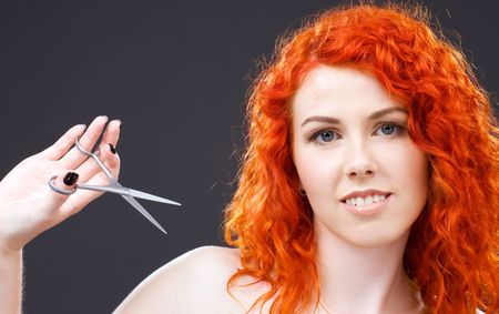 picture of lovely redhead with scissors over grey Stock Photo - 4977241