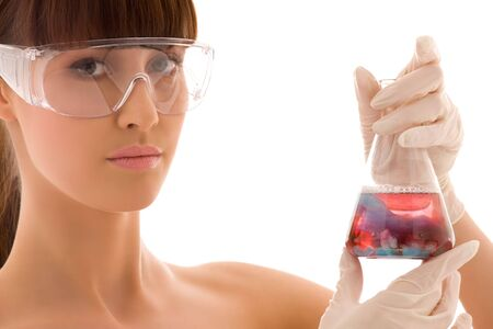 closeup of beautiful lab worker holding up test tube Stock Photo - 4987581