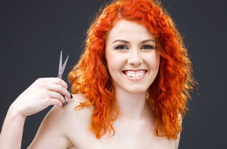picture of lovely redhead with scissors over grey Stock Photo - 5012792