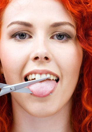 lovely redhead cutting tongue with scissors Stock Photo - 5012781