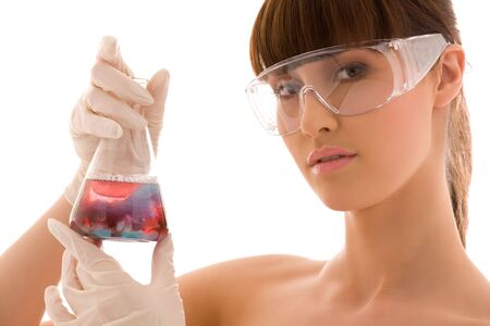 closeup of beautiful lab worker holding up test tube Stock Photo - 5012786