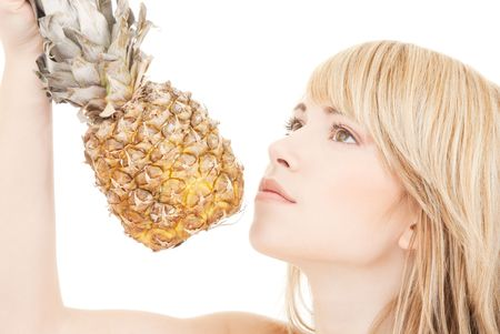 bright picture of lovely blonde with pineapple Stock Photo - 5031304