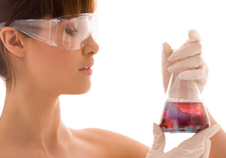 closeup of beautiful lab worker holding up test tube Stock Photo - 5057770