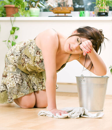 bright picture of lovely housewife cleaning floor Stock Photo - 5057769