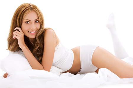 picture of lovely woman with pillow in bed Stock Photo - 5197003