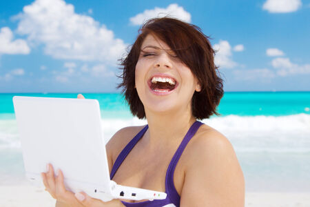 lovely woman with laptop computer on the beach Stock Photo - 5196925
