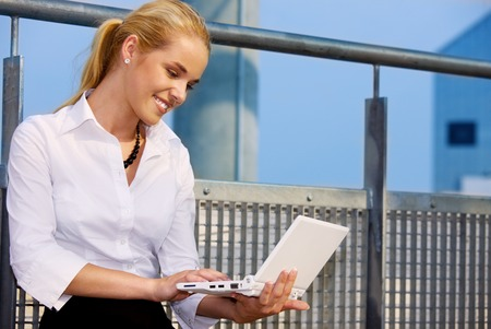picture of happy businesswoman with laptop computer Stock Photo - 5197177