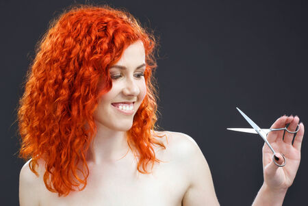 picture of lovely redhead with scissors over grey Stock Photo - 5197263