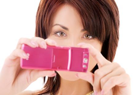 Foto de mujer feliz usando la c�mara del tel�fono Foto de archivo - 5197103