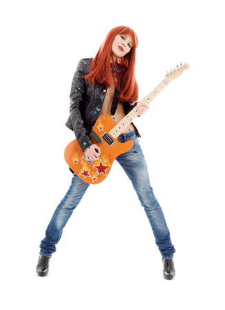 picture of lovely redhead girl with orange guitar Stock Photo - 5196856