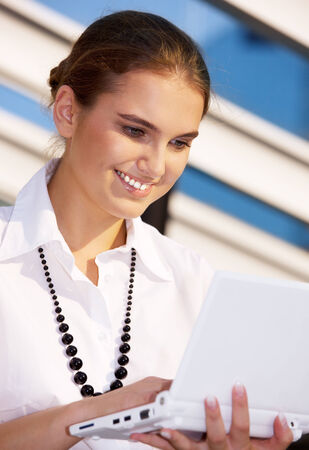 picture of happy businesswoman with laptop computer photo