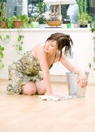 bright picture of lovely housewife cleaning floor Stock Photo - 5197115