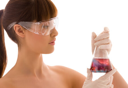 closeup of beautiful lab worker holding up test tube Stock Photo - 5197013