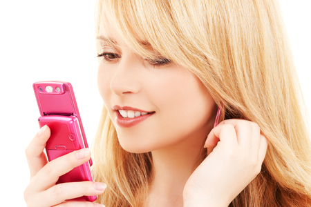 sms: picture of happy teenage girl with cell phone