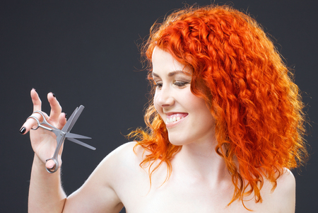 picture of lovely redhead with scissors over grey Stock Photo - 5197264