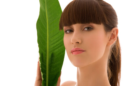 picture of woman with green leaf over white Stock Photo - 5343417