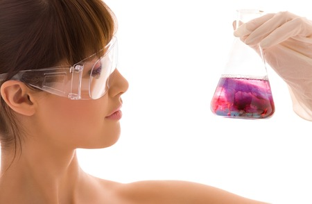 closeup of beautiful lab worker holding up test tube Stock Photo - 5196965