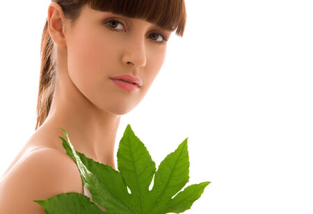 picture of woman with green leaf over white Stock Photo - 5197019