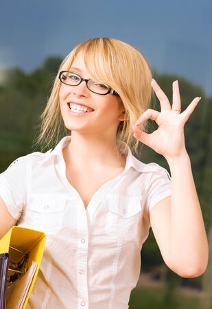 bright picture of young businesswoman in office Stock Photo - 5348609