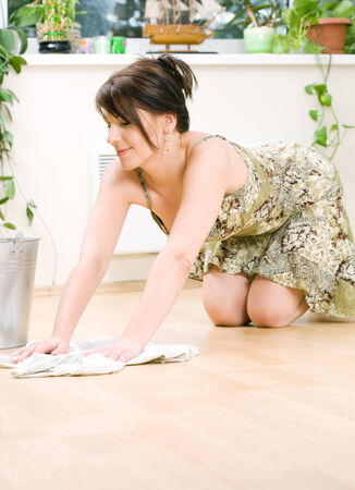 bright picture of lovely housewife cleaning floor Stock Photo - 5348452
