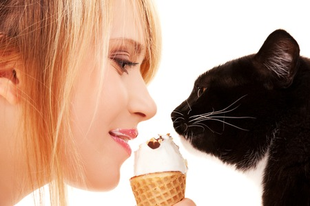 woman face cream: picture of lovely girl and cat with ice cream