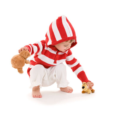 picture of little girl with plush toys over white Stock Photo - 5348222