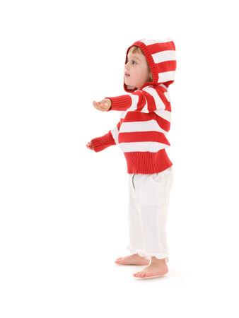 extending: picture of little girl extending hand over white LANG_EVOIMAGES