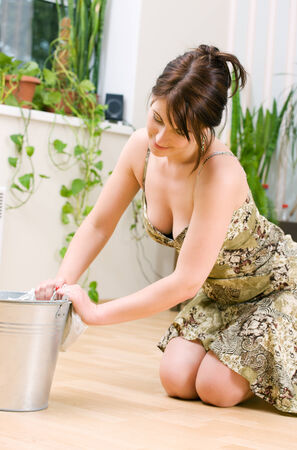 bright picture of lovely housewife cleaning floor Stock Photo - 5349405