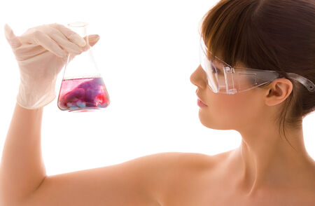 closeup of beautiful lab worker holding up test tube Stock Photo - 5348346