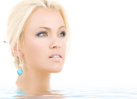 bright picture of lovely blonde in water photo