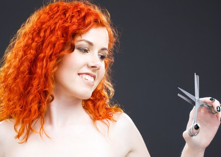 picture of lovely redhead with scissors over grey Stock Photo - 5349388
