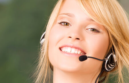 bright picture of friendly female helpline operator Stock Photo - 5348510