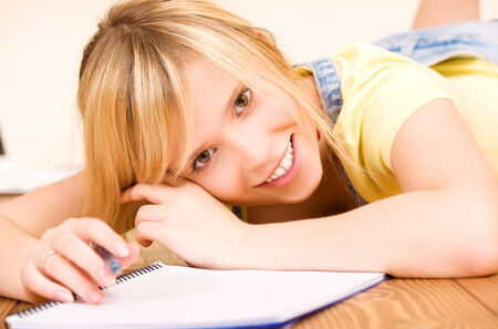 picture of teenage girl with notebook and pen Stock Photo - 5348546