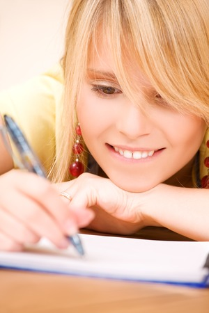 picture of teenage girl with notebook and pen Stock Photo - 5348550