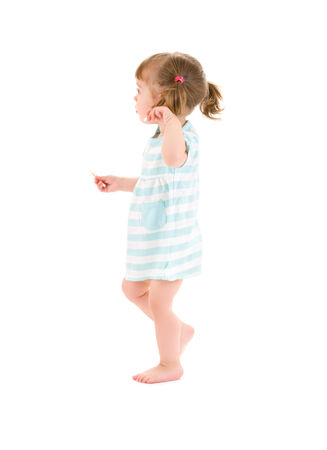 toddler walking: picture of little girl with cotton sticks over white
