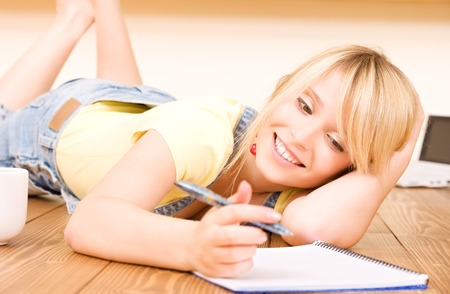 picture of teenage girl with notebook and pen Stock Photo - 5348534