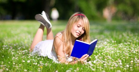 outdoor picture of lovely teenage girl with book Stock Photo - 5348545