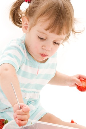 picture of little girl with strawberry over white Stock Photo - 5348424